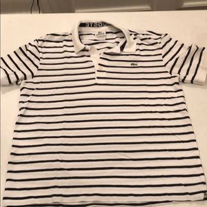 White and navy striped Lacoste polo.